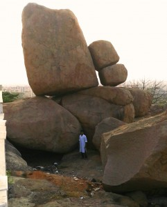 Fascinating volcanic rock formations abound in all the hilly parts of Hyderabad. I had  a person stand in front of these rocks, just to show the immense size of these rocks, placed like toy pieces on top of each other.