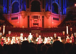 Musicians dressed in period costumes performing Vivaldi's Four Seasons  in the magnificent Royal Albert Hall